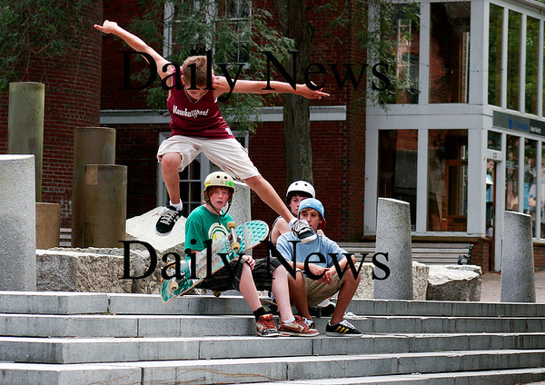 Newburyport: Trevor Bradbury, of Newburyport, ollies a set of steps on Inn Street with his friends closley watching on Monday afternoon. Photo by Ben Laing/Staff Photo