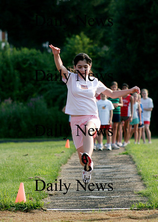 West Newbury: Rachel Arone, 11, of Boxford, participates in the long jump during Tuesday night's River Rival's track meet in Pentucket. Photo by Ben Laing/Staff Photo