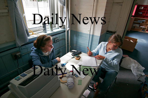 Newburyport: Callie Gillis, left, and Arielle Boches, right, both seniors at Newburyport High, get things in order at the Snacktory Factory, the snack bar at the Kelley School drop in center, which opens on Tuesday. Photo by Ben Laing/Staff Photo