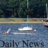 Newburyport: A student at the American Yacht Club's sailing school flipped his sailboat while manuevering around the Merrimack River off Joppa flats Tuesday. Photo by Ben Laing/Staff Photo