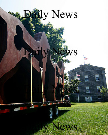 Newburyport: A collection of dog sculptures wait to be unloaded on the waterfront, behind the Customs House in Newburyport. Photo by Ben Laing/Staff Photo