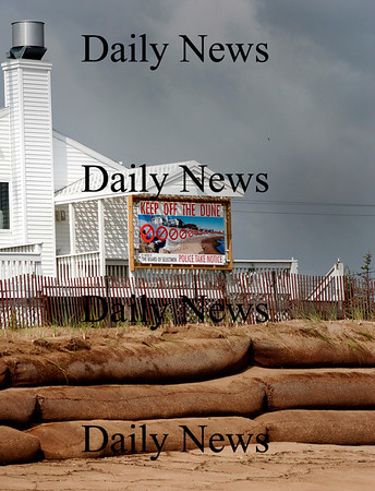 Newbury: A warning sign reminds beachgoers to stay off the fragile dune at Plum Island Center. Photo by Ben Laing/Staff Photo