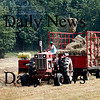 Newburyport: A tractor bails hay on the Sweeney Farm on Hale Street in Newburyport Monday afternoon. Photo by Ben Laing/Staff Photo