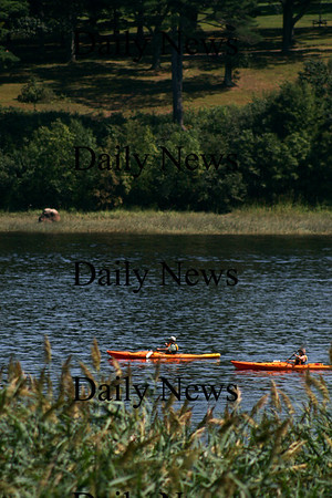 Amesbury: A pair of kayakers paddle down the Merrimack River near Hatter's Point in Amesbury Sunday afternoon, with scenic Maudslay State Park in the background. Photo by Ben Laing/Staff Photo