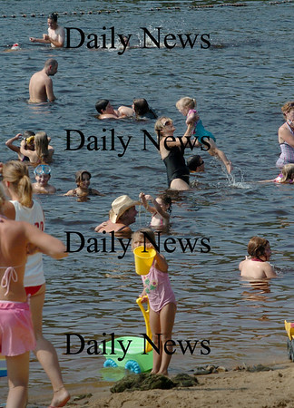 Amesbury: While Lake Attitash has high levels of a toxic algae, swimmers were in abundance at Lake Gardner Beach on Monday afternoon. Bryan Eaton/Staff Photo Newburyport News Monday August 17, 2009.