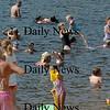 Amesbury: While Lake Attitash has high levels of a toxic algae, swimmers were in abundance at Lake Gardner Beach on Monday afternoon. Bryan Eaton/Staff Photo Newburyport News Monday August 17, 2009.