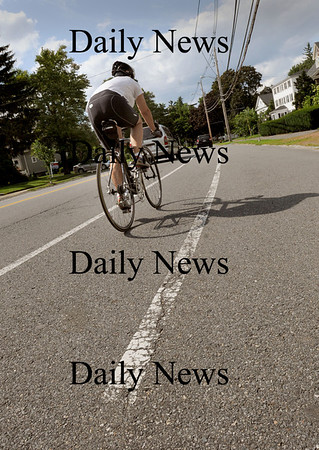 Newburyport: The lines marking the bicycle lane on High Street in Newburyport are wearing down from use over the years. Bryan Eaton/Staff Photo Newburyport News  Thursday August 6, 2009.