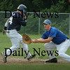 Rowley: Rowley Rams first baseman Joe White is ready for the throw as Rory Gentile makes it back on a steal attempt. Bryan Eaton/Staff Photo Newburyport News Wednesday August 5, 2005.