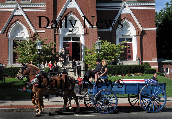 Amesbury: The body of Thomas W. Moore was taken to St. Joseph's Church by a horse-drawn carriage for his funeral yesterday morning. He was Amesbury's first injured soldier during the Korean Conflict. Bryan Eaton/Staff Photo Newburyport News Thursday August 27, 2009.
