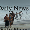 Salisbury: Though the beach in Salisbury was closed, some people headed part-way into the surf during high tide yesterday afternoon. Bryan Eaton/Staff Photo Newburyport News Sunday August 23, 2009.
