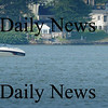 Amesbury: A boat tows a raft with a couple teenagers at Lake Attitash on Monday afternoon. Bryan Eaton/Staff Photo Newburyport News Monday August 17, 2009.