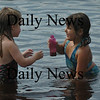 Cheyenne Nock, 5, right, of Salisbury pulls sand from the bottom of Lake Gardner to put into a jar as she plays with her newly-made friend Norah Ryan, 4, of Amesbury at Lake Gardner Beach on Monday afternoon. Bryan Eaton/Staff Photo  Newburyport News  Monday August 10, 2009.