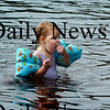 Amesbury: Avery Summer has the best of both worlds eating cereal while getting cooled off. The 19-month year-old was at Lake Gardner Beach yesterday with some friends. Bryan Eaton/Staff Photo Newburyport News Thursday August 20, 2009.