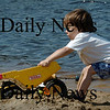 Amesbury: Noah Reynolds, 3, uses all his strength to pull a Tonka Truck that he filled with sand at Lake Gardner Beach Wednesday morning. He was there with his brother, Ian, 5, and mom, Rebekah of Merrimac,  Bryan Eaton/Staff Photo  Newburyport News   Wednesday August 26, 2009.