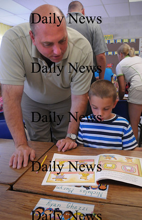Amesbury: Nicholas Muryn, 6, with his dad Paul, check out his desk in Sue Holt's first grade class at Amesbury Elementary School Monday during an open house. Bryan Eaton/Staff Photo Newburyport News Monday August 31,  2009.