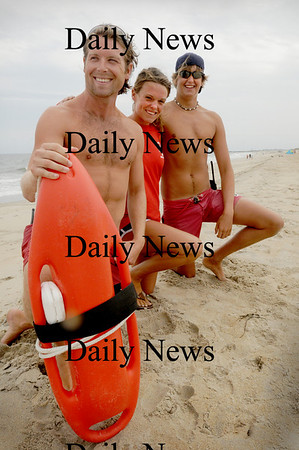 Salisbury: These Salisbury Beach State Reservation lifeguards took first place in a recent state competition. From left, CJ Cronin and Meghan Feran of Haverhill and Adam Eramo of Rowley.  Bryan Eaton/Staff Photo Newburyport News  Thursday August 13, 2009.