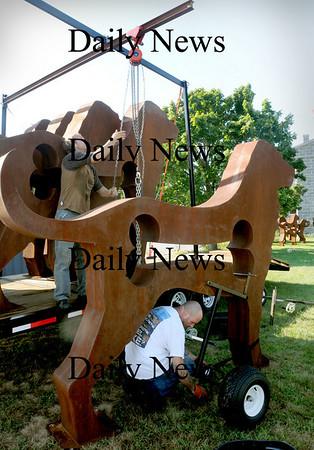 Newburyport: Artist Dale Rogers, left, unloads his dog sculptures with associate Gregg Gravlin.  Bryan Eaton/Staff Photo  Newburyport News   Wednesday August 26, 2009.