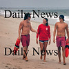 Salisbury: Salisbury Beach lifeguard who came first in a statewide contest, from left, CJ Cronin and Meghan Feran, both of Haverhill and Adam Eramo of Rowley. Bryan Eaton/Staff Photo Newburyport News  Thursday August 14, 2009.