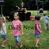 Salisbury: Children dance to the music of Nancy Sweeney on Wednesday morning at the Salisbury Public Library. It was the last day of the summer reading program with the music being followed by an ice cream social. Bryan Eaton/Staff Photo  Newburyport News Wednesday August 12, 2009.