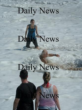 Salisbury: One man took adavantage of the strong surf at Salisbury Beach yesterday for an impromptu whirlpool bath. Bryan Eaton/Staff Photo Newburyport News Sunday August 23, 2009.