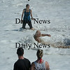 Salisbury: One man took adavantage of the strong surf at Salisbury Beach yesterday for an impromptu whirlpool bath. Bryan Eaton/Staff Photo Newburyport News Sunday August 23, 2009.