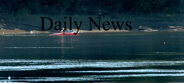Amesbury: A kayaker heads up the Merrimack River off Amesbury's Point Shore as seen from Alliance. The first part of the weekend may not be good for water sports as Tropical Storm Danny may drop rain in the area. Bryan Eaton/Staff Photo Newburyport News Thursday August 27, 2009.