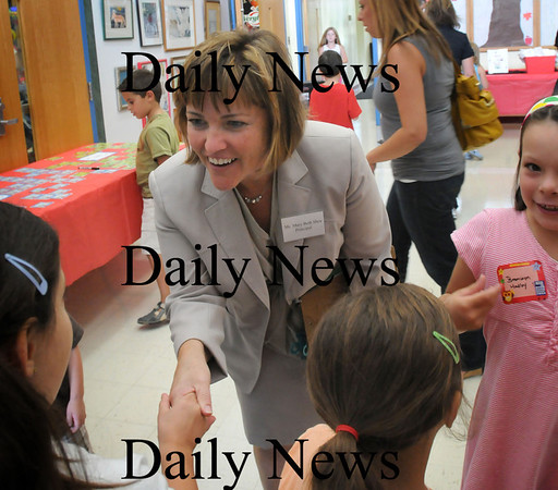 Merrimac: New principal of the Sweetsir School in Merrimac, Mary Beth Shea, greets children Monday as they come into school a day early to meet their teachers. Bryan Eaton/Staff Photo Newburyport News Monday August 31, 2009.