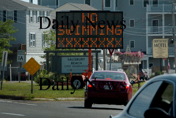 Salisbury: A sign at the entrance to Salisbury Beach State Reservation warns of the strong surf and rip currents due to Hurricane Bill. Bryan Eaton/Staff Photo Newburyport News Sunday August 23, 2009.