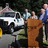 Newbury: Governor's Academy Headmaster Marty Doggett speaks to town officials during a presentation of a pickup truck, pictured, which the school donated to the town of Newbury. From left, selectmen Geoff Walker, Audrey Keller, Chairman Joe Story.  Bryan Eaton/Staff Photo  Newburyport News Monday August 31, 2009.