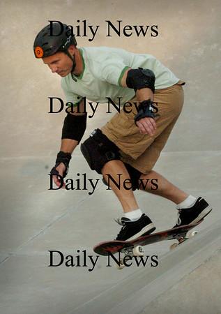 Newburypoprt: Steve Forcucci, 46, of Winchester goes through his routine at the Newburyport Skateboard Park. He's a member of G.O.N.E. (Geezers of New England) who travel to different parks. Bryan Eaton/Staff Photo Newburyport News Wednesday August 5, 2005.