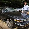 "Salisbury: John Wall, Jr. of Wall's Ford in Salisbury with three ""clunkers""  destined for the scrapyard. Bryan Eaton/Staff Photo Newburyport News  Friday August 7, 2009."