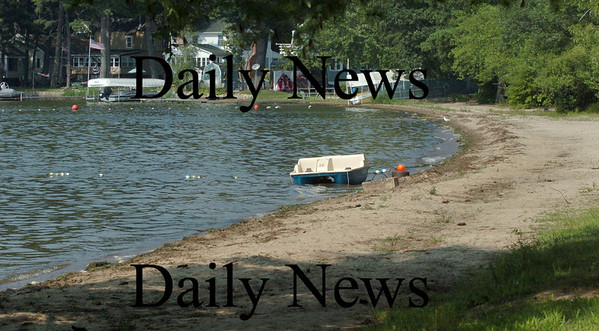 Amesbury: There was no activity at Lake Attitash Associates' beach on Monday as a warning posted at the gate warns of unsafe levels of blue-green algae. Bryan Eaton/Staff Photo Newburyport News Monday August 17, 2009.