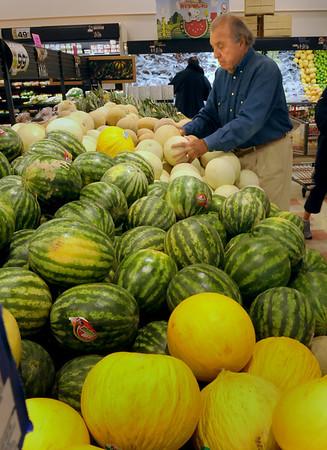Newburyport: Harvey Beit checks out the melon selection at DeMoulas' Market Basket in Newburyport.  Bryan Eaton/Staff Photo Newburyport News  Monday August 3, 2009.