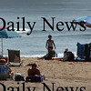 Salisbury: The ocean was much more calmer for beach-goers at Salisbury Beach State Reservation on Tuesday afternoon. The beaches had been closed Sunday and Monday due to rough seas from Hurrican Bill. Bryan Eaton/Staff Photo Newburyport News Tuesday August 25, 2009.