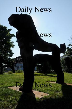 Newburyport: Dale Rogers is setting up his dog sculptures behind the Custom House Maritime Museum. Bryan Eaton/Staff Photo  Newburyport News   Wednesday August 26, 2009.