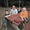 Georgetown: Jake Richards, 5, in front with his family brother Josh, 7, dad Kent and Mom Rachael at American Legion Park in Georgetown. Jake  is being recognized by the fire department for his quick thinking that helped to avert a very serious fire in his parent's home.<br /> Jim Vaiknoras/Staff photo