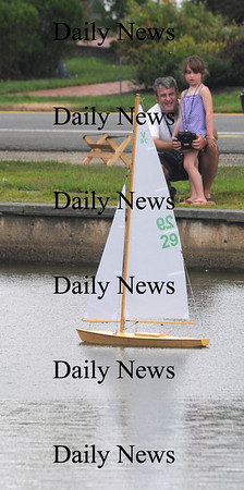 Newbury: TJ Clark of Newburyport and his daughter Delany, 7,  sail a remote control boats on the Upper Green in Newbury. The boat was one of 2 they family built and were sailing Saturday afternoon. Jim Vaiknoras/Staff photo