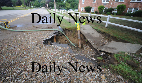 Amesbury: Water from a broken fire hydrant on Lion's Mouth Road in Amesbury dug a large hole in the sidewalk near Amesbury Park.The hydrant was possebly struck my a vehicle saturday night.JIm Vaiknoras/Staff photo
