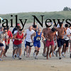 Salisbury:Runners head out on the sand in the 31st annual Salisbury Beach Life Guard 5 Mile Run. Jim Vaiknoras/Staff photo