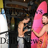 Seabrook: Laurie-Anne Thouin and Lisa-Anne Racine shop for  boards at Zapstix Surf Shop in Seabrook Friday. This weekends weather is expected to create a high surf on local beaches.Jim Vaiknoras/Staff photo