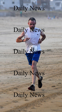 Salisbury: Dan Verrington sprints to victory  in the 31st annual Salisbury Beach Life Guard 5 Mile Run. Jim Vaiknoras/Staff photo