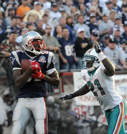 Foxboro: Randy Moss (81) catches a Tom Brady pass for a successful two point conversion against Vontae Davis (21) during Sunday's game against Miami. Photo by Ben Laing/Staff Photo