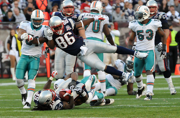 Foxboro: Tight End Chris Baker (86) leaves his feet throwing a block for running back Laurence Maroney (39) as the Patriots defeated the Dolphins 27-17 Sunday at Gillette Stadium. Photo by Ben Laing/Staff Photo
