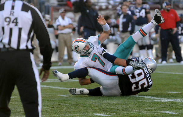 Foxboro: Tully Banta-Cain (95) gets tangled up with quartertback Chad Henne (7) of the Dolphins during Sunday's Patriots victory. Photo by Ben Laing/Staff Photo