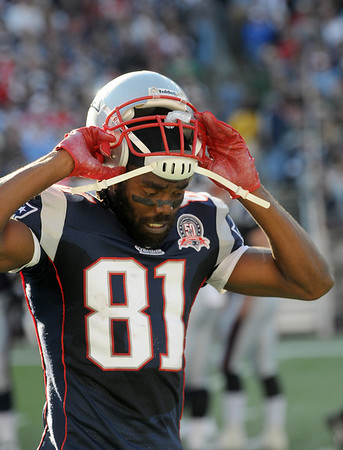 Foxboro: Receiver Randy Moss (81) shows some frustration after a stalled offensive drive in Sunday's game against the Dolphins. Photo by Ben Laing/Staff Photo