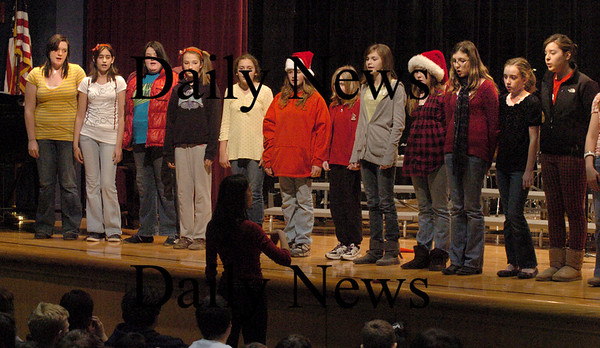 """Amesbury: The Melody Club at Amesbury Middle School sings """"Jubilate Deo"""" on Wednesday afternoon during a winter concert for the whole school with performances also by each grade's chorus. It was the first time in several years the entire school has been able to enjoy a concert by the whole school because of the high school's recent addition and renovations. Bryan Eaton/Staff Photo"""