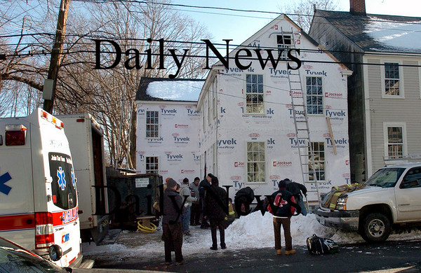 Newburyport: Two workers were injured from falls working on this house at 27 Kent Street in Newburyport early Tuesday afternoon. Bryan Eaton/Staff Photo