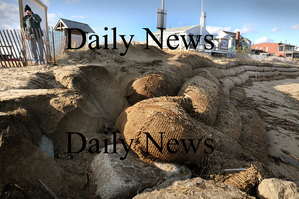 Newbury: Erosion again has taken place at Plum Island Center after Wednesday's windy storm, removing sand from behind the southern end of the giant string of sandbags. Bryan Eaton/Staff Photo