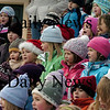 "Amesbury: Students from Amesbury Elementary School  sing ""Jingle Bells""  in the amphitheater at the Upper Millyard on Monday afternoon. About 100 family members came out to hear the student's annual event. Bryan Eaton/Staff Photo"