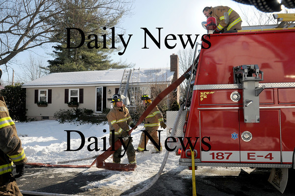 Merrimac: Firefighters wrap up at a small house fire in Merrimac late Wednesday morning. Bryan Eaton/Staff Photo